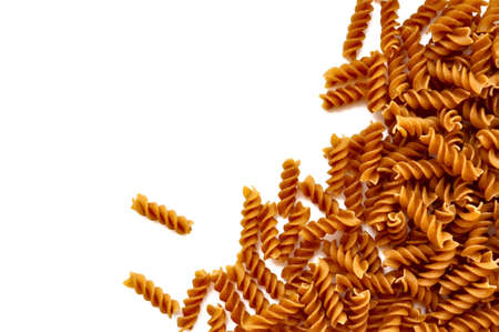 Background - Wholemeal pasta, isolated on a white background. With space for text or image. photo
