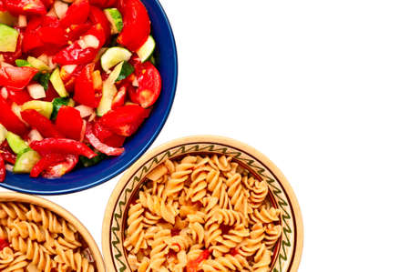 A bowl of salad and two plates with pasta with tomatoes, isolated on white background Stock Photo - 14715942