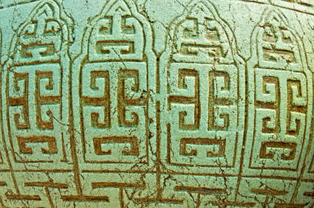 indian artifacts: Abstract Background - maya stone ornament on a vase.