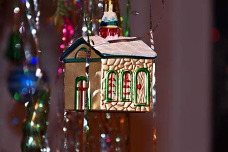 housewarming: Christmas ornament - a ornate house on a fir-tree Stock Photo