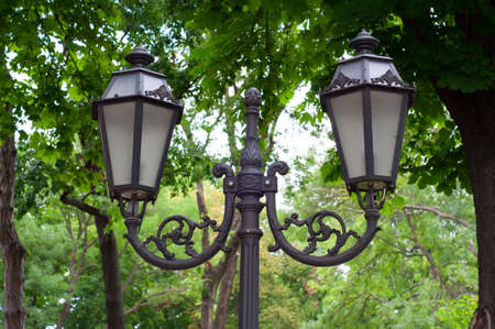 Double Lamppost in the city park  Closeup  photo