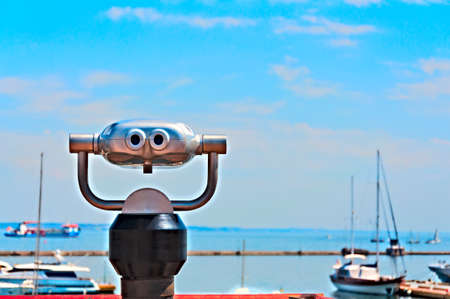 lookout: Binoculars on the seafront  Closeup