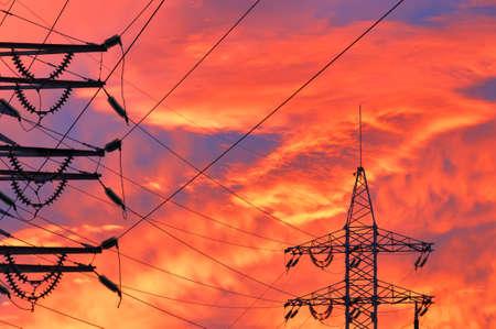 over voltage: High Voltage Line over sunset background.
