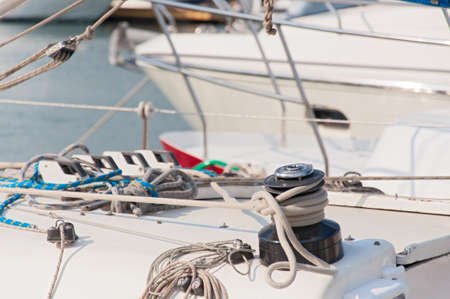 Winch with rope on sailing boat. Yacht detailed parts. photo
