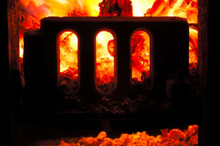 Grate boiler furnace with coals inside. Closeup. photo