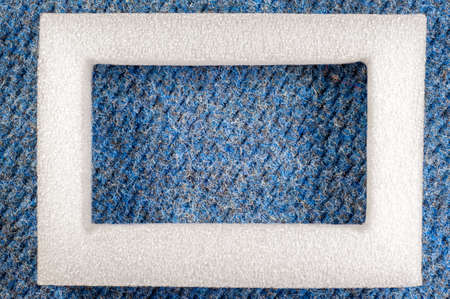 polyfoam: Abstract background - Polyfoam frame on a carpet texture. Stock Photo