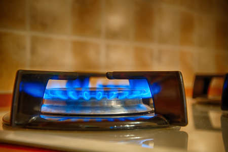 Gas On Kitchen - gas torch in kitchen. Closeup. Stock Photo - 25034648