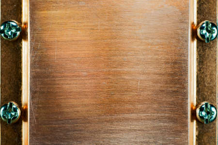 Metal Plate Background - copper plate fastened by bolts, may be used as a frame. photo