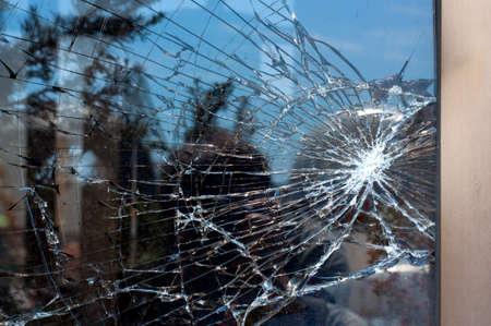 vehicle window: Broken Glass with outdoor street reflection. Closeup. Stock Photo