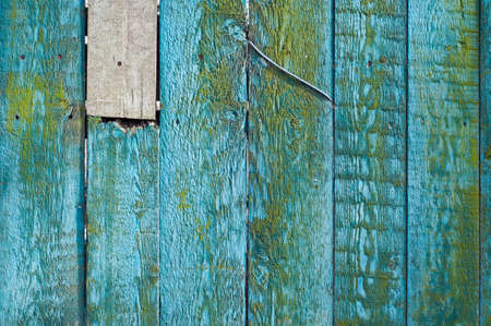 fixed: Old Rustic Painted fence, damaged and fixed. Stock Photo