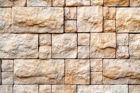 brick texture: Decorative Bege Stone Random Size Brick Wall Texture For Your Design. Stock Photo