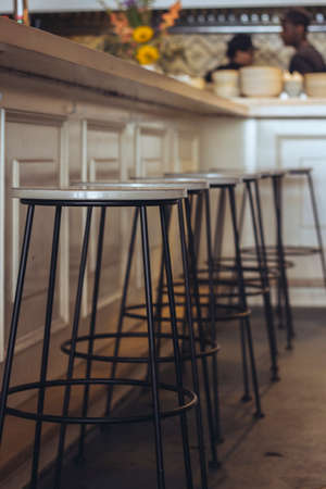 Stools and bar counter in a coffee shop Imagens