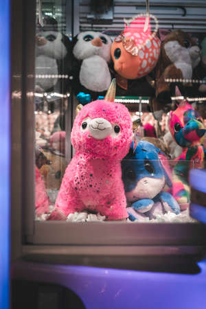 Stuffed Animal Alpaca at An Arcade Claw Machine