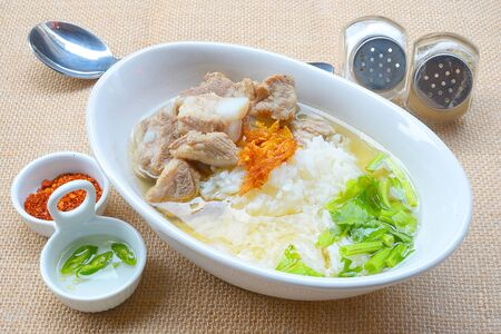 boiled rice with pork rib hot soup on bowl