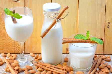 claen: Almond milk with almond on a wooden table