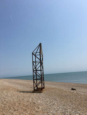 english channel: Rusty metal structure on Dungeness beach over looking the English Channel Stock Photo