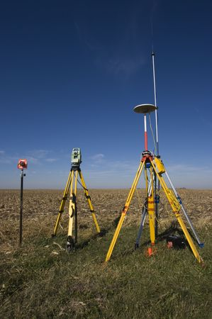 theodolite: GPS unit, Total station and Prism set in the field.