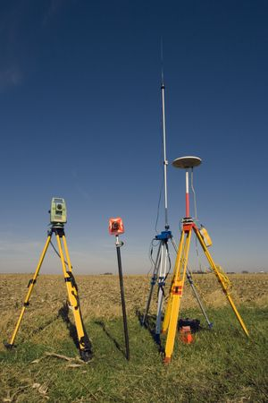 GPS unit, Total station and Prism set in the field. photo