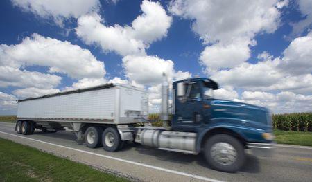 Blurred semi-truck seen under crazy clouds. Reklamní fotografie