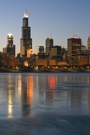 magnificent mile: Skyscrapers reflected in icy Lake Michigan - Chicago, Il. Stock Photo