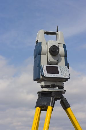 Theodolite seen against cloudy sky