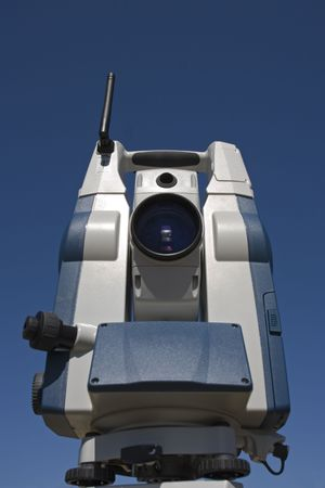 Theodolite with blue sky as a background.