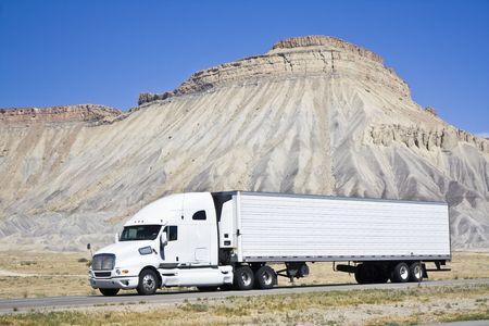 White semi truck driving in Colorado photo