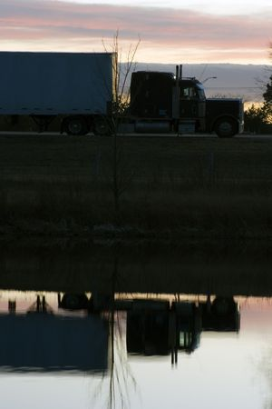 semitruck: Semi-truck reflected in the pond.
