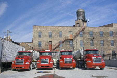 Red trucks in concrete factory - Chicago, IL. photo