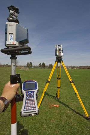 Robotic station with a prism pole and data collector ready for work. Stock Photo - 4072987