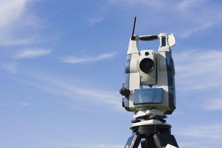 Theodolite against blue sky. photo
