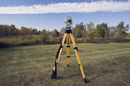 cartographer: October surveying - instrument set in the field. Stock Photo