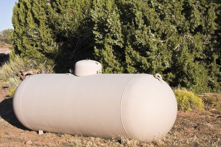 propane tank: Gas Tanks and some trees.