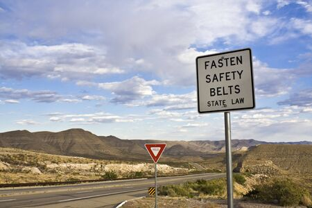 fasten: Fasten your belt - thats th law. Stock Photo