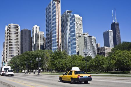 Yellow taxi in downtown Chicago, IL. Stock Photo - 4073073