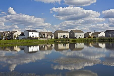 Suburban community reflected in the pond photo