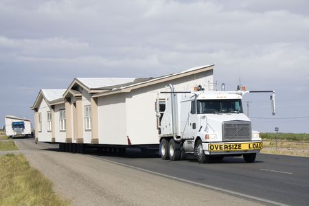 Transporting portable homes - New Mexico. Stock Photo