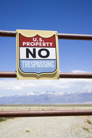 trespasser: US property - no trespassing sign.