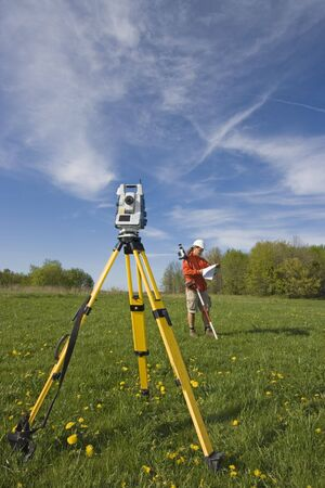 surveyor: Analizing a map - spring land surveying. Stock Photo