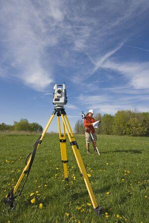 Analizing a map - spring land surveying. photo