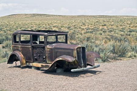 jalopy: Old car left on the desert.