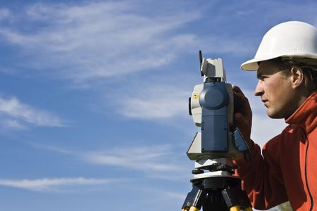 Behind Theodolite - spring land surveying.