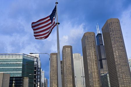 aon: US flag and Presidential Towers in Chicago, IL. Stock Photo