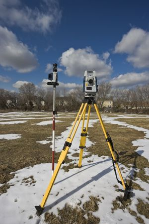 Winter land surveying - total station. photo