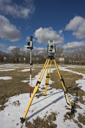 Winter land surveying - total station. photo