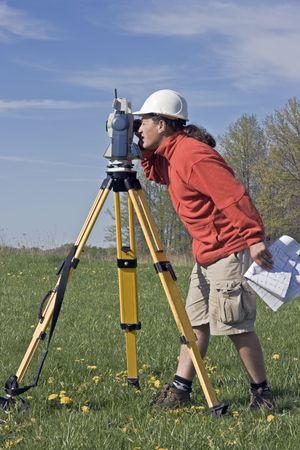 Land Surveyor at Work, spring time. photo
