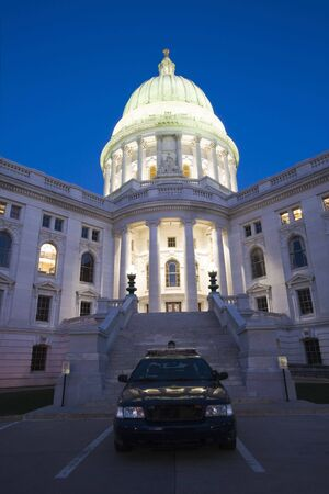 bldg: Police car in front of State Capitol Bldg in Madison