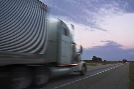 truck driver: Truck driving during colorful sunset Stock Photo