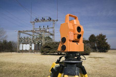 Surveying electric compound - spring land surveying. photo