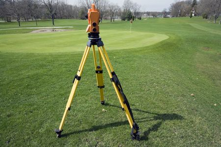 land surveying: Land surveying the golf course - spring time. Stock Photo